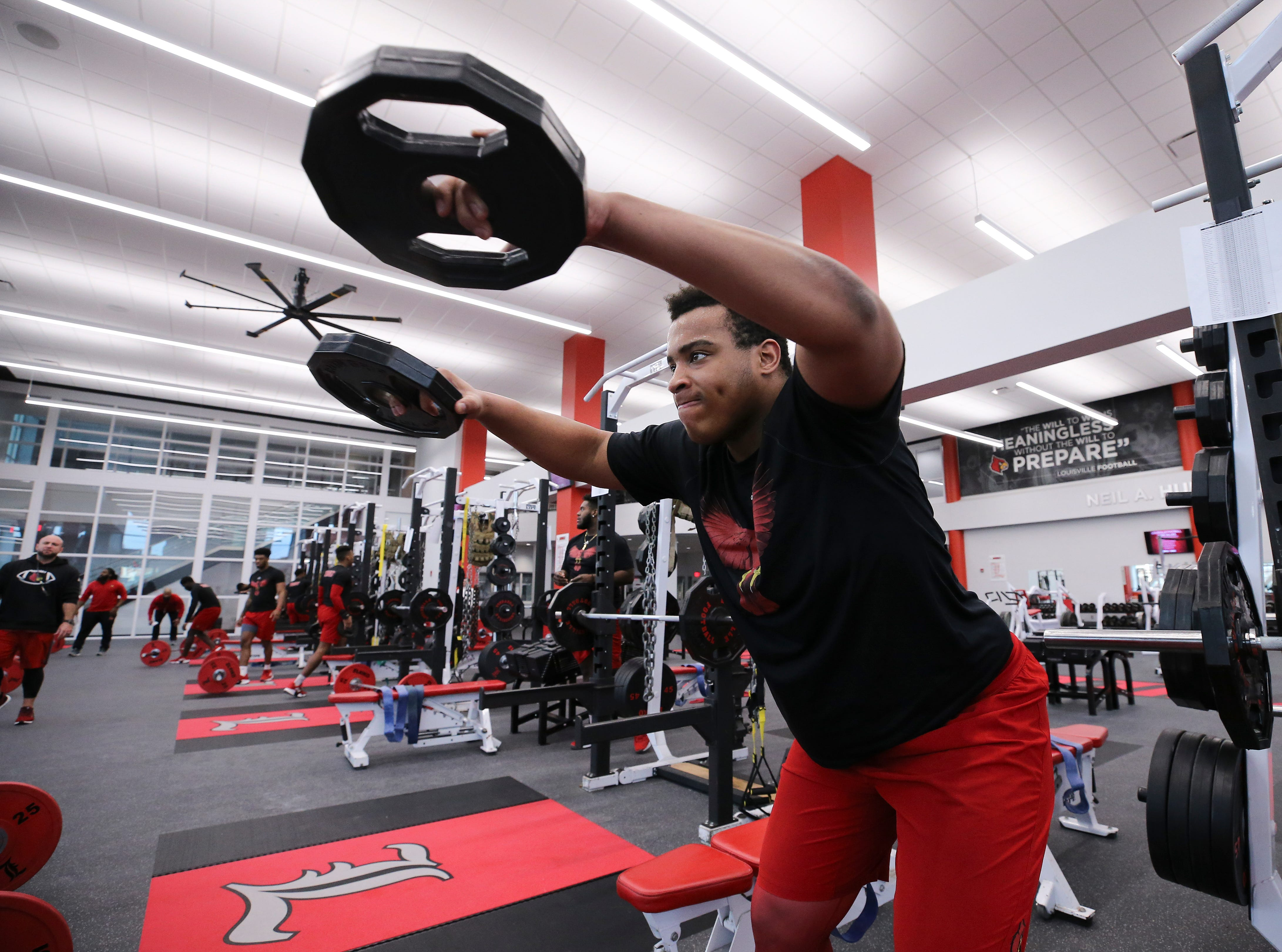U of L's Caleb Chandler works out during strength and conditioning at the Schnellenberger Complex.
