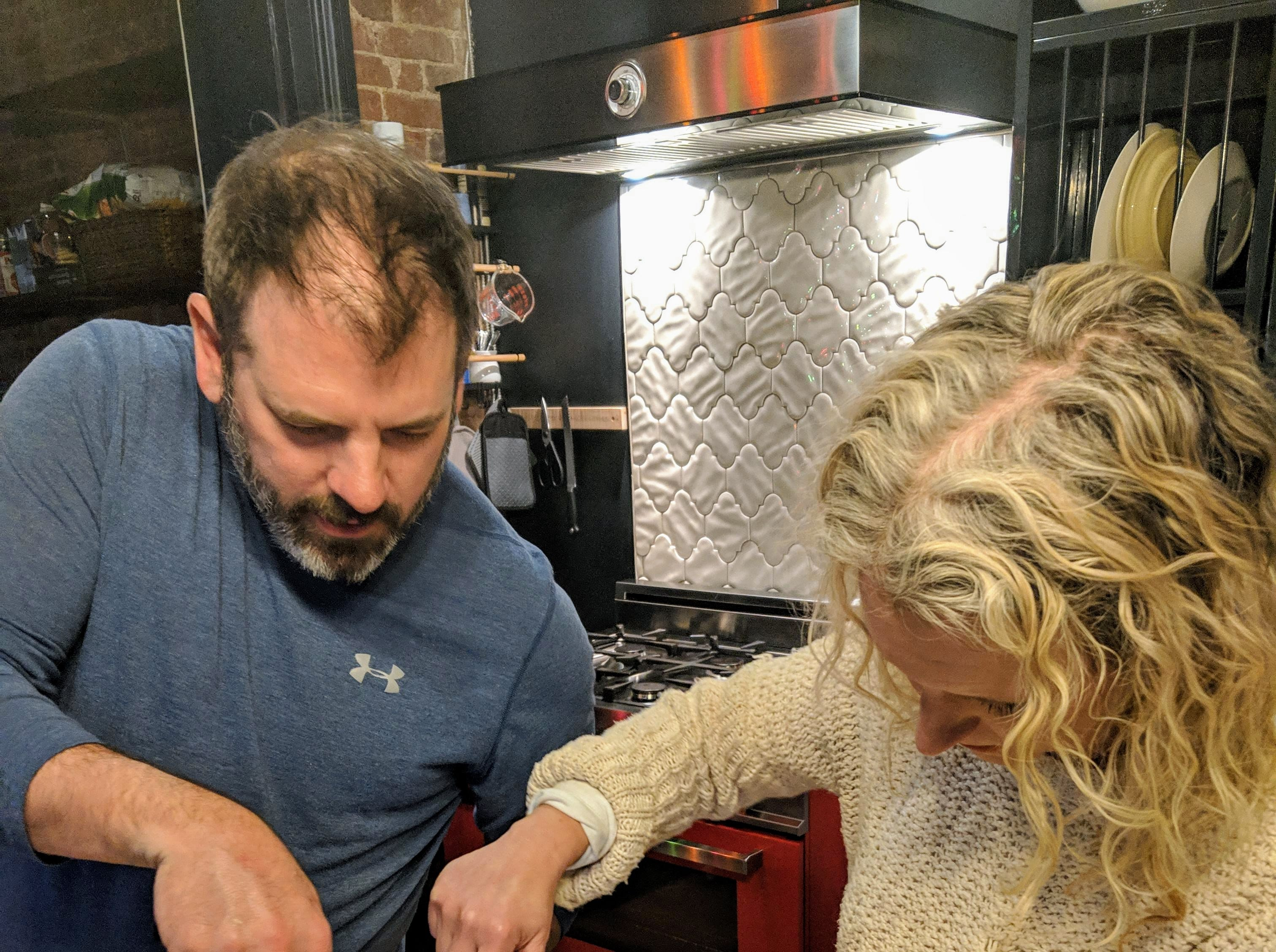 Louisville chef Michael Crouch shows food writer Dana McMahan the proper technique for butchering a whole duck.