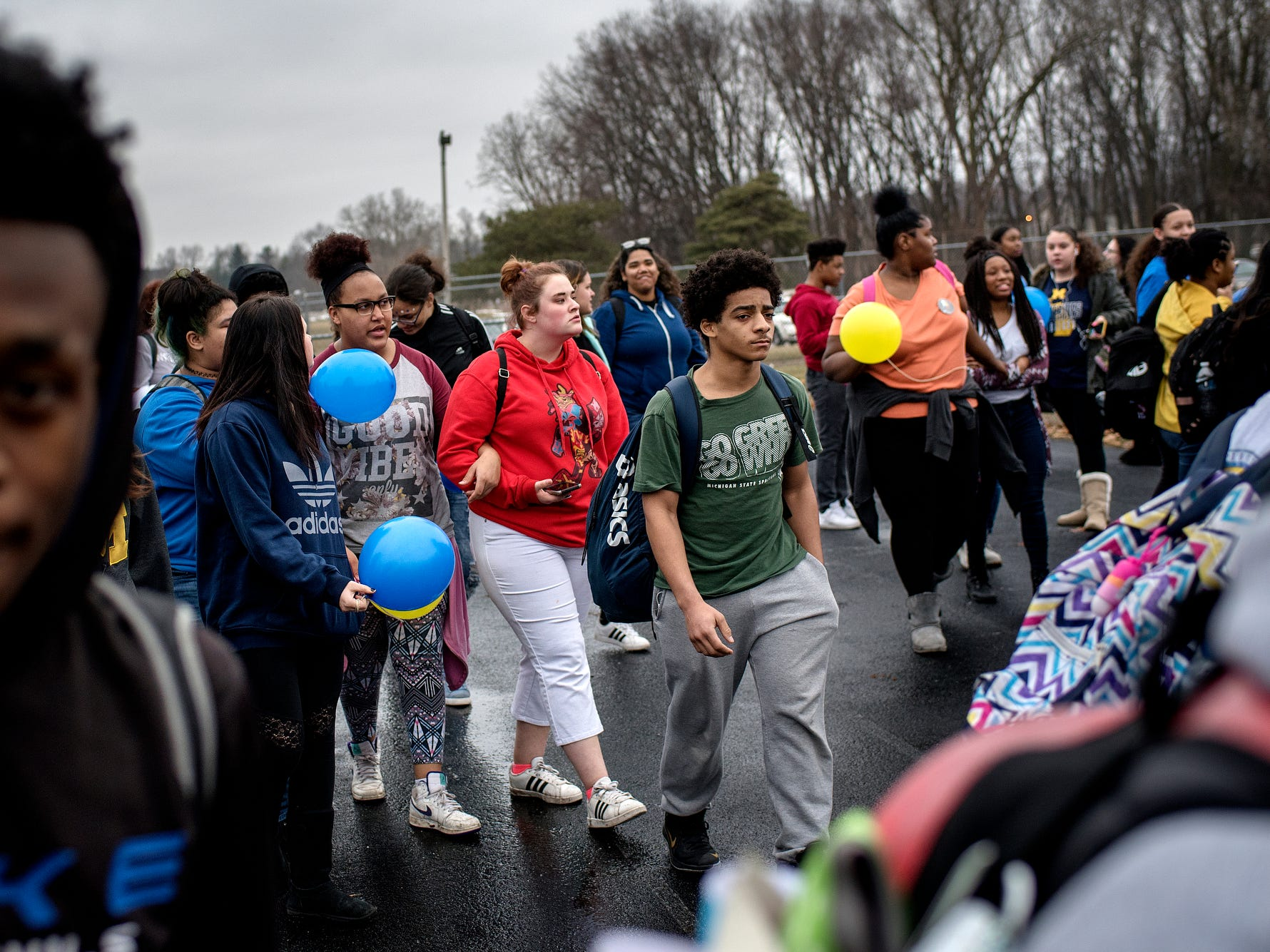 Students walk from the front of the school to the football field to release balloons in honor of classmate 8th-grader Michael Martin at Everett New Tech High School on Monday, Feb. 4, 2019, in Lansing. Michael, 13, died Jan. 25, at Sparrow Hospital, two days after attempting suicide in his home. Joanna Wohlfert, Michael's mother, said her son had endured months of bullying.