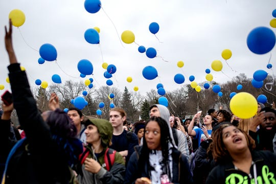 Students release balloons in honor of fellow classmate 8th-grader Michael Martin at Everett New Tech High School on Monday, Feb. 4, 2019, in Lansing. Michael, 13, died Jan. 25, at Sparrow Hospital, two days after attempting suicide in his home. Joanna Wohlfert, Michael's mother, said her son had endured months of bullying.