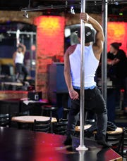 Cassius Haywood-Johnson, a cook, has practiced hard for Sunday's Omar's Show Bar male revue.