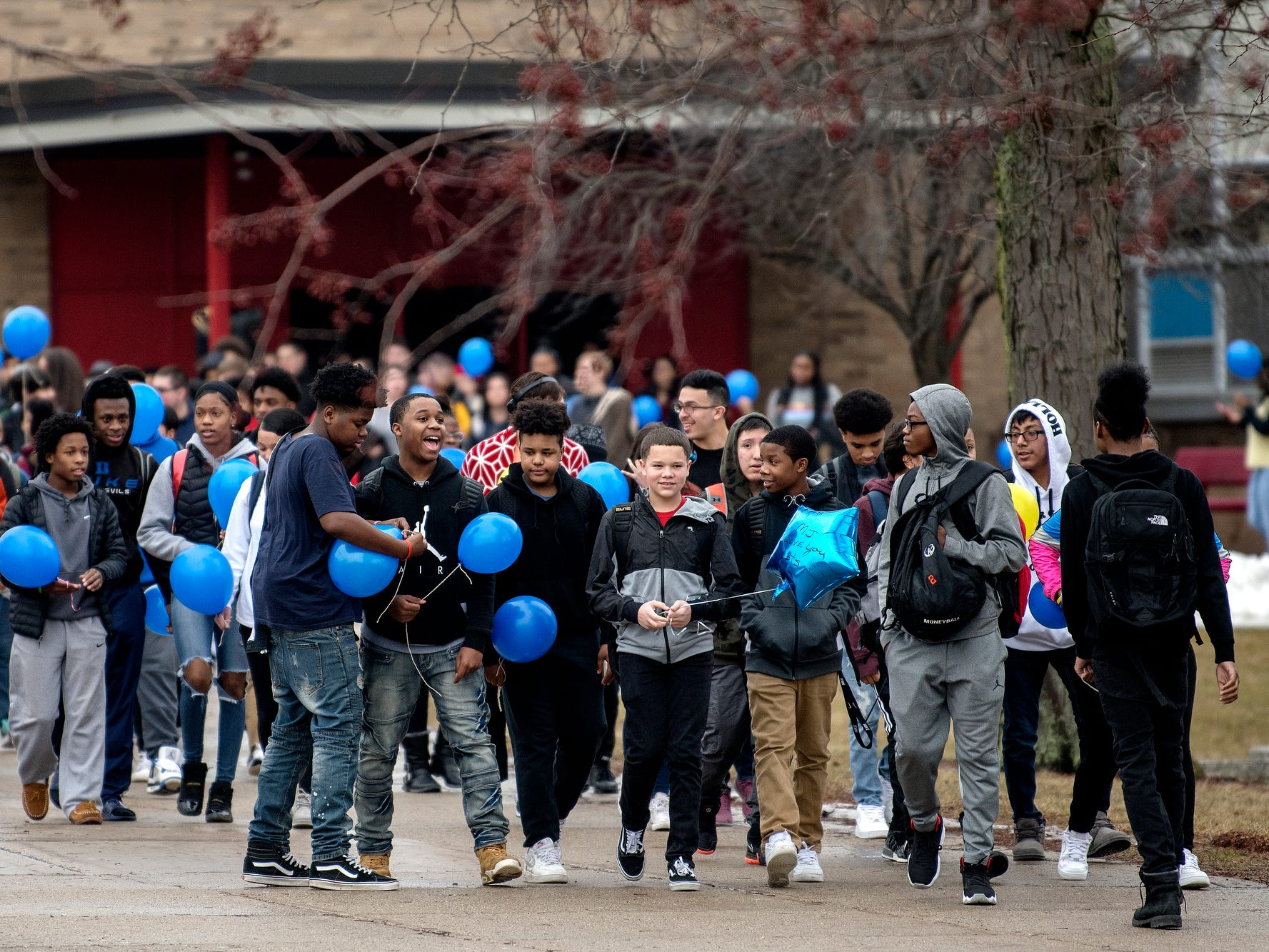 Students walk from the front of the school to the football field to release balloons in honor of fellow student 8th-grader Michael Martin at Everett New Tech High School on Monday, Feb. 4, 2019, in Lansing. Michael, 13, died Jan. 25, at Sparrow Hospital, two days after attempting suicide in his home. Joanna Wohlfert, Michaels mother, said her son had endured months of bullying.