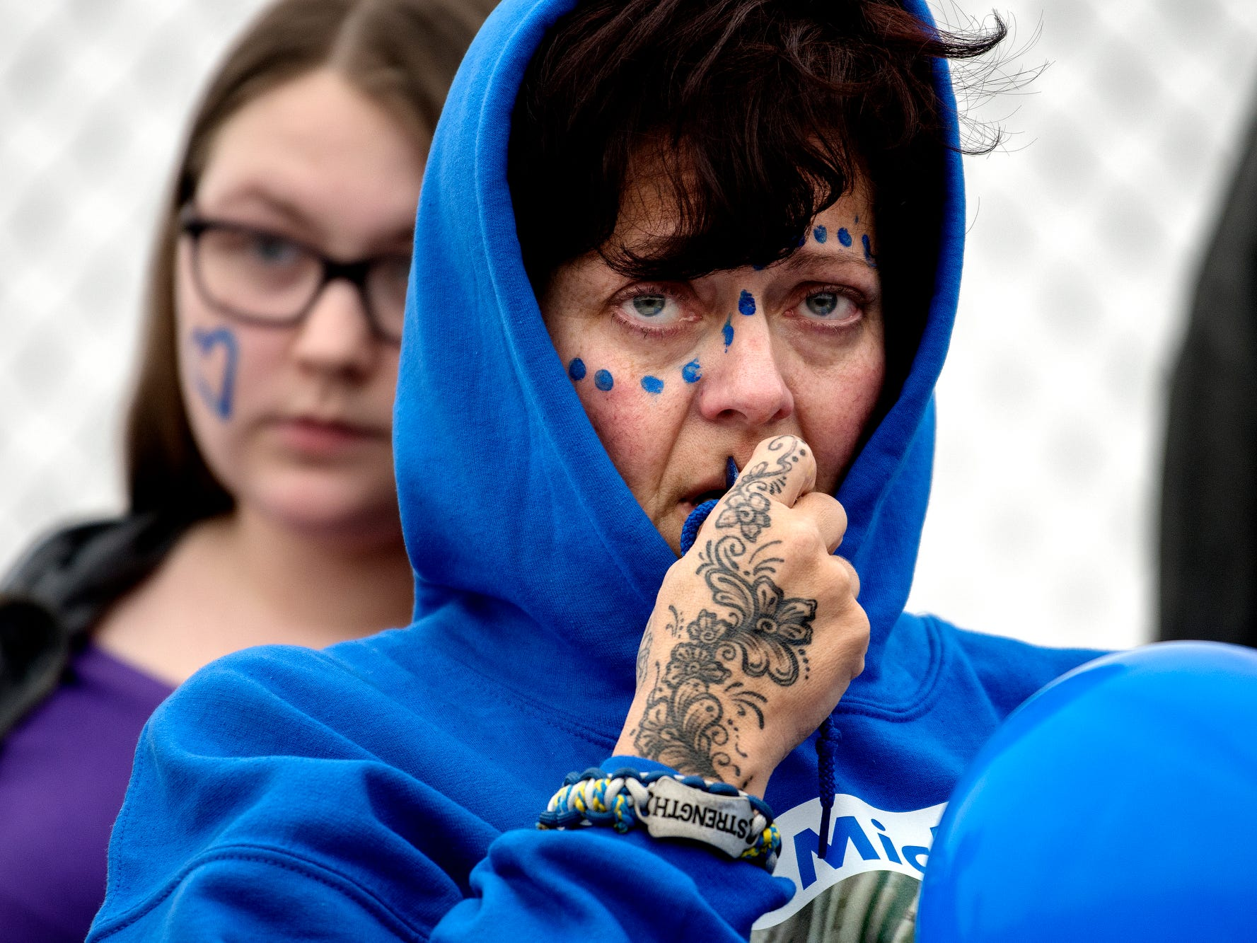 Joanna Wohlfert, the mother of 8th-grader Michael Martin, looks on during a short ceremony honoring her son on the football field at Everett New Tech High School on Monday, Feb. 4, 2019, in Lansing. Michael, 13, died Jan. 25, at Sparrow Hospital, two days after attempting suicide in his home. Wohlfert said her son had endured months of bullying.