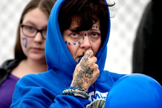 Joanna Wohlfert, the mother of 8th-grader Michael Martin, looks on during a short ceremony honoring her son on the football field at Everett New Tech High School on Monday, Feb. 4, 2019, in Lansing. Michael, 13, died Jan. 25, at Sparrow Hospital, two days after attempting suicide in his home.