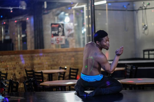 Cassius Haywood-Johnson, from Detroit, is a college student in Lansing who finds it fun to be an exotic dancer.