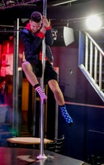 L.J. Holmes is a Holt native who enjoys earning money as an exotic dancer. He said the group of men who performed at Omar's Show Bar in November have what it takes to become a successful touring group.
