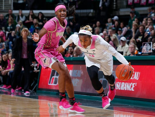 Michigan State's Shay Colley, right, drives against Purdue's Lyndsey Whilby, Sunday, Feb. 3, 2019, in East Lansing, Mich.