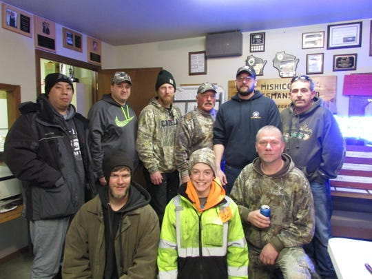 First-place winners in Mishicot Sportsmen's Club's 29th annual fishing derby are, front row, from left: David Vang, Derek Mueller and C.J. Tuschl; and back row, from left: Terry Wiensch, Mark Mancheski, Skip Duellman, Matt Meyer, Brian Eis and Scott Tadych.