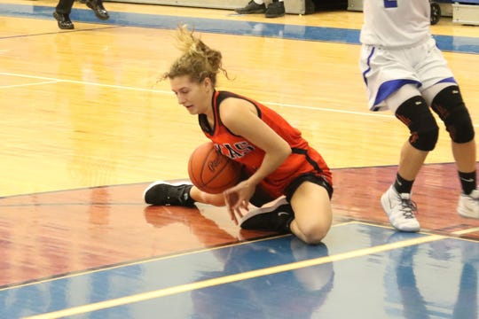 Lucas' Jamie Grover dives on a loose ball during the Lady Cubs' win at Crestline last week.