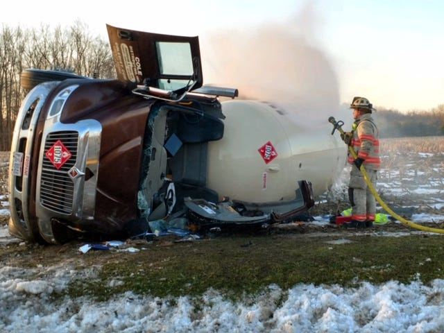 Ashland Assistant Fire Chief Gabe Campbell sprays water on a leaking propane truck Monday morning after 7:33 a.m. on Ohio 511 at Township Road 2104.
