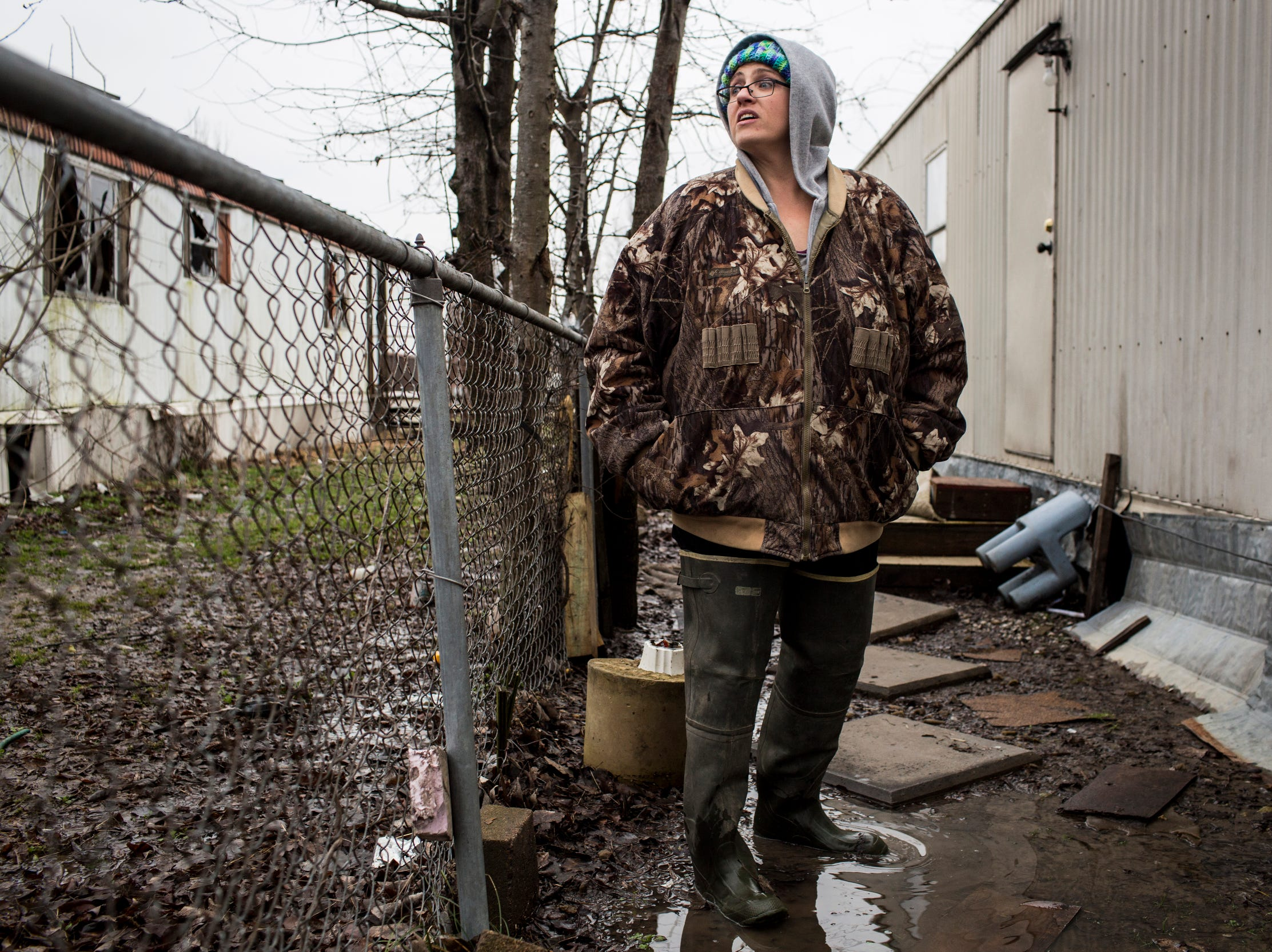 "January 23, 2019 - Debbie Camp stands near her home in Lakeshore where she lives with her children. In December of 2017, Debbie Camp, a mother of three who owns a trailer in Lakeshore, called the Arkansas Department of Environmental Quality to complain, ""Sewage is running everywhere.""  She said she's frustrated that she hasn't seen any follow-up. ""Nobody cares, just cause we're a trailer park,"" Camp said. Records obtained by The CA show that Camp's complaint was received. But, the Arkansas Department of Environmental Quality said they have no inspection report resulting from her complaint, though they believe the issue was related to a residential line as opposed to the main sewer."