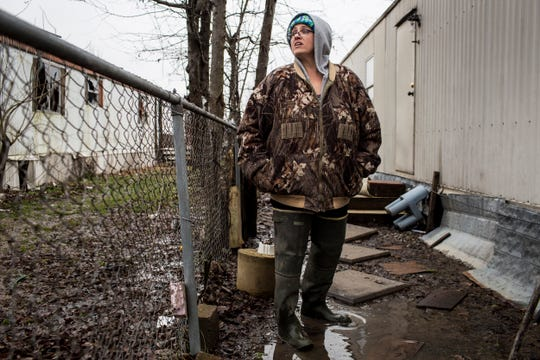 "Debbie Camp stands near her home in Lakeshore where she lives with her children. In December 2017, Camp, a mother of three who owns a trailer in Lakeshore, called the Arkansas Department of Environmental Quality to complain, ""Sewage is running everywhere."""