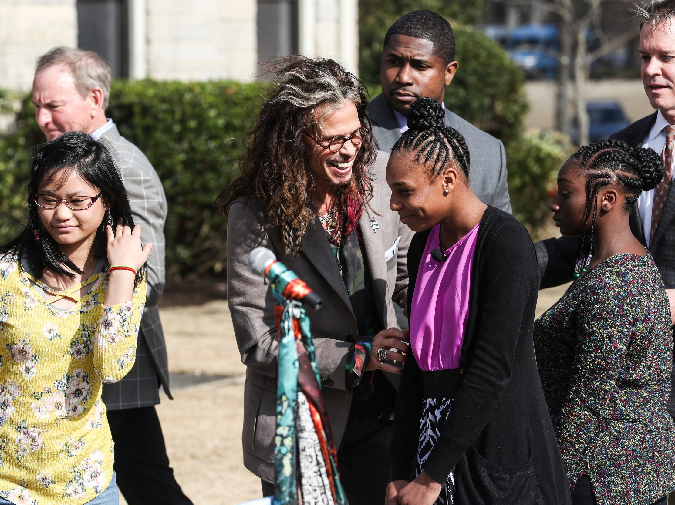 Singer Steven Tyler attends the scarf-cutting celebration Feb. 4, 2019, for Janie's House, a project between Tyler and Youth Villages to renovate a home for girls who have suffered abuse or neglect.