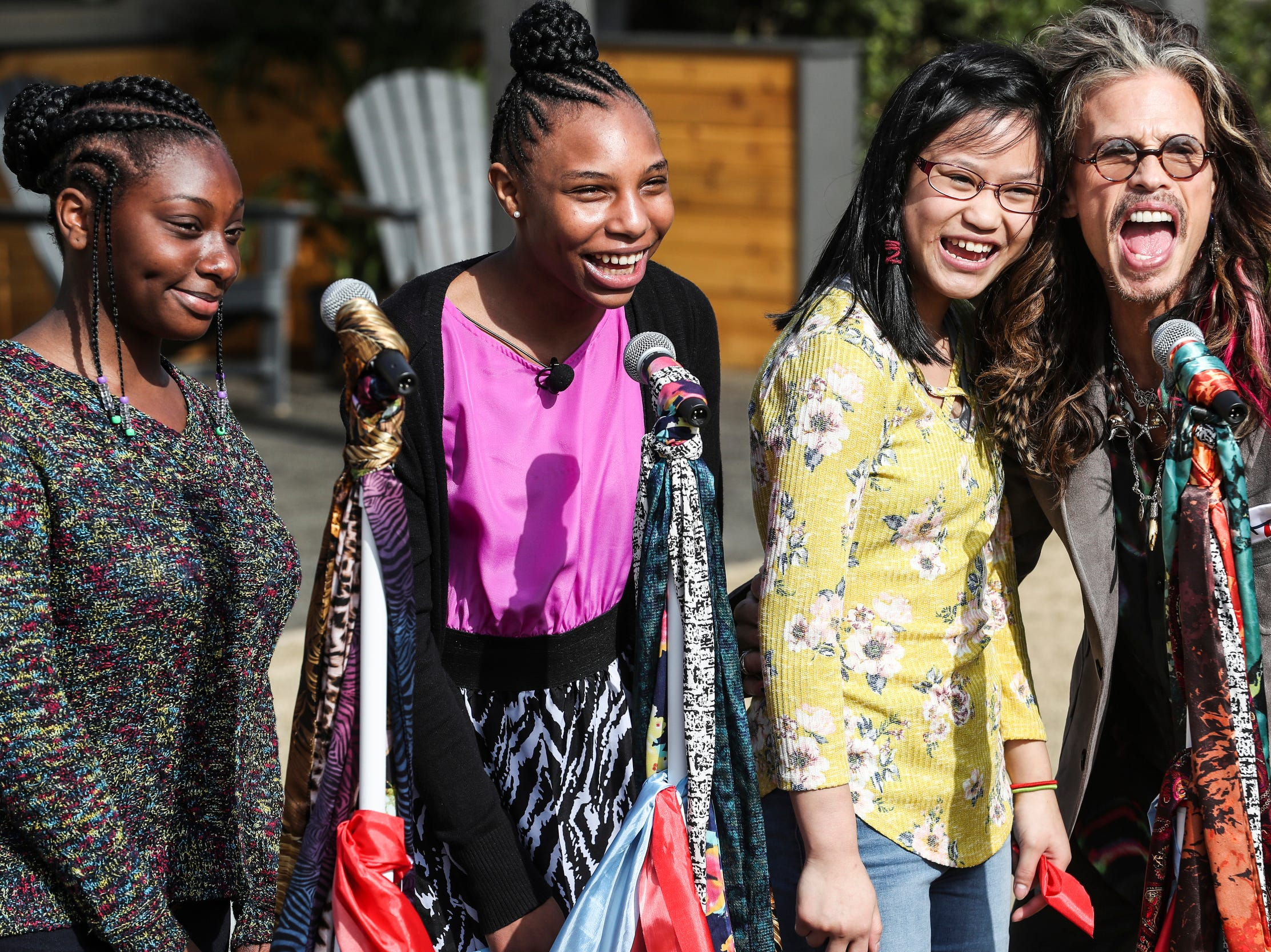 February 04 2019 - From left, Sylvia, JaBrayia, Jenna, and Steven Tyler pose for photos during a scarf-cutting celebration outside of Janie's House at Youth Villages in Bartlett. Janie's Fund paid for the renovations of the existing home for girls and Youth Villages renamed it a Janie's House.