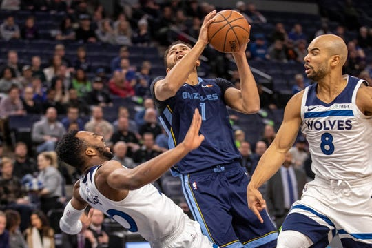 Grizzlies forward Kyle Anderson (1) attempts to shoot the ball as  Timberwolves guard Josh Okogie (20) defends in the first half Jan 30, 2019, at Target Center.
