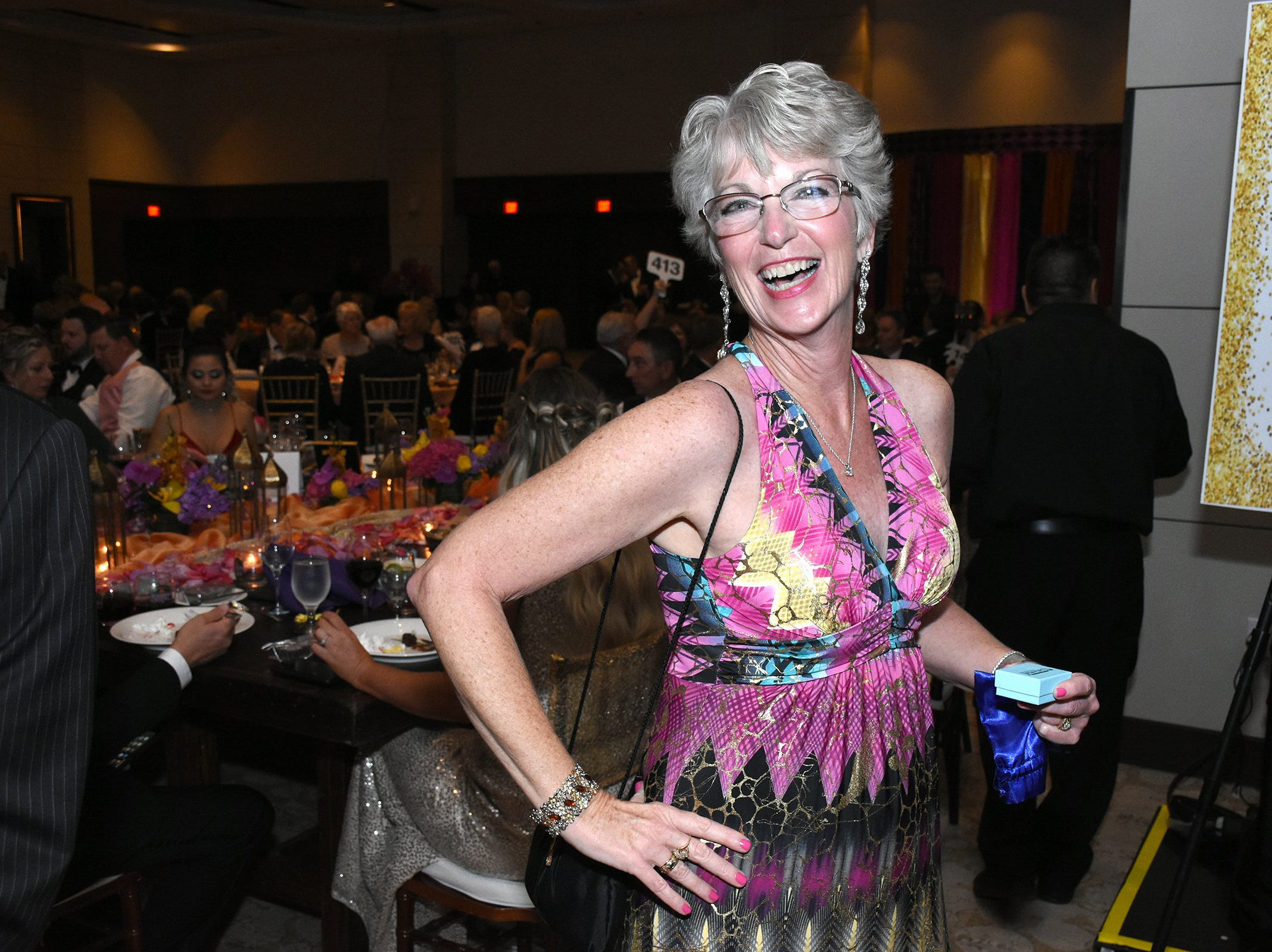 Volunteer Maureen Chodaba as she won the two carat diamond earrings from Kathein Jewelers of Marco. The Marco Island unit of the American Cancer Society held the Imagination Ball Friday evening at the JW Marriott hotel, raising funds to continue the fight against cancer.