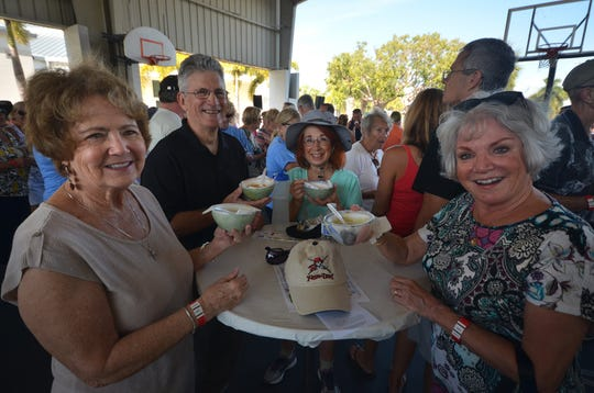 Ginny Bauersfeld, from left, Randy and Debbie Plough, and Varla Bare enjoy their bowls. The Souper Bowl, connecting hundreds of Islanders with soups from nine local eateries, raised funds for Chamber of Commerce scholarships Saturday at Mackle Park.