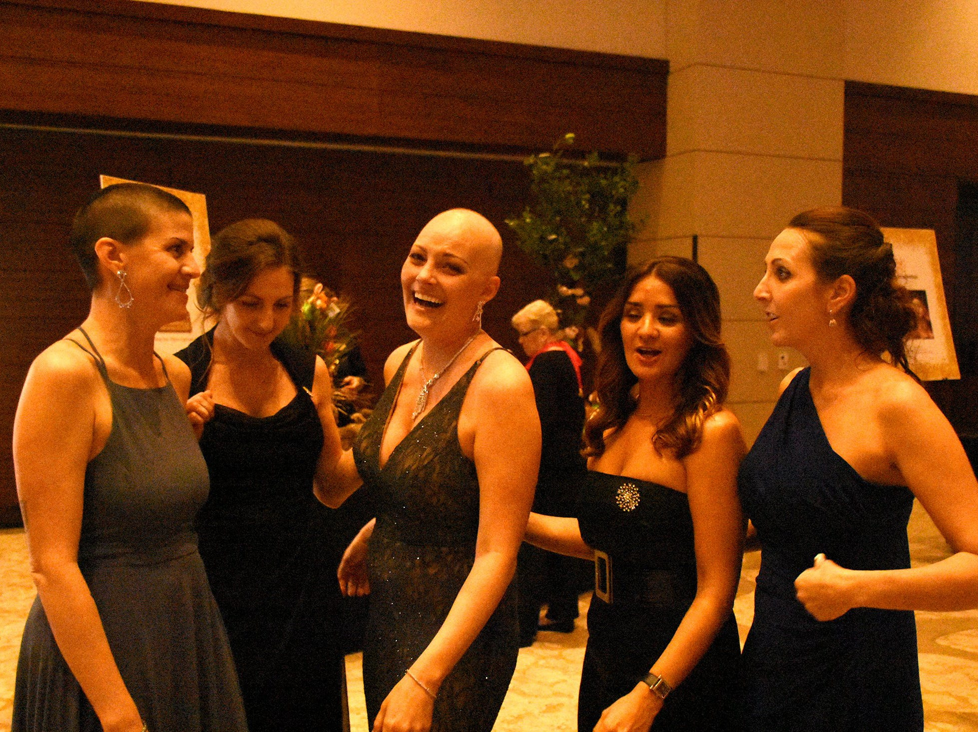 Lauren Ross, center, shared her struggle with the crowd. The Marco Island unit of the American Cancer Society held the Imagination Ball Friday evening at the JW Marriott hotel, raising funds to continue the fight against cancer.