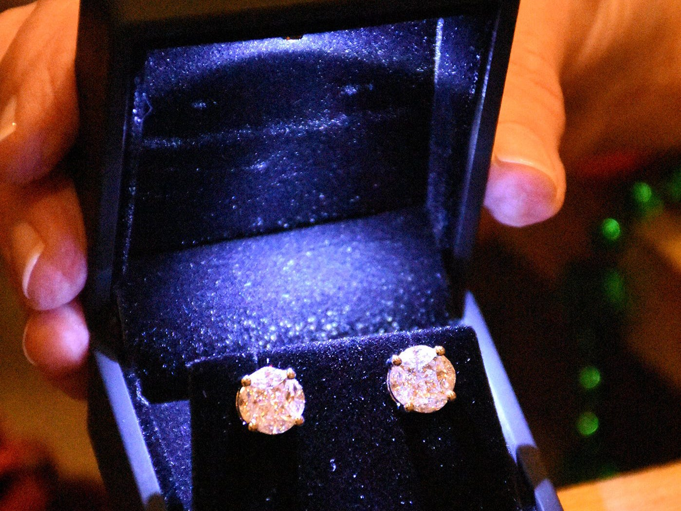 Two carat diamond earrings from Kathein Jewelers of Marco. The Marco Island unit of the American Cancer Society held the Imagination Ball Friday evening at the JW Marriott hotel, raising funds to continue the fight against cancer.