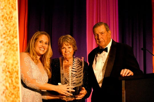 Grado Award winners Anne and Gary Landis accept their award from Amanda Cox, left. The Marco Island unit of the American Cancer Society held the Imagination Ball Friday evening at the JW Marriott hotel, raising funds to continue the fight against cancer.