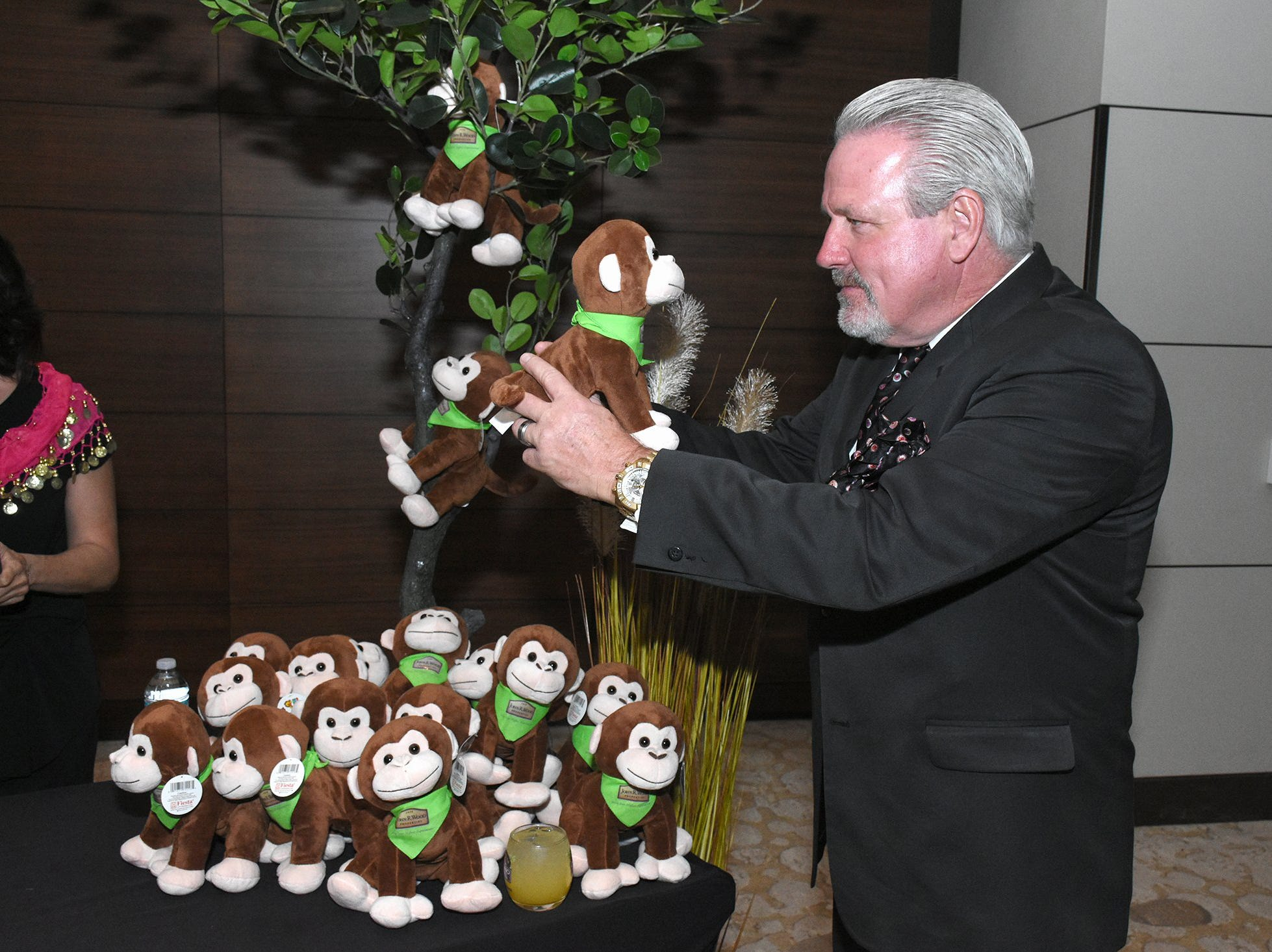 Jimmy Downey shares a moment with huggable animals whose purchase went to hospitalized children. The Marco Island unit of the American Cancer Society held the Imagination Ball Friday evening at the JW Marriott hotel, raising funds to continue the fight against cancer.