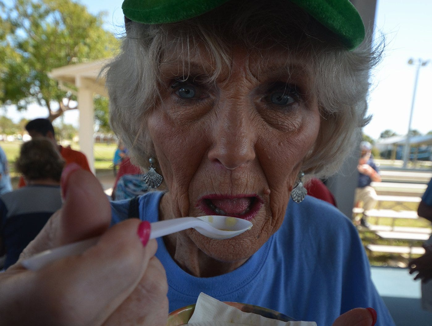 Volunteer Susie Walsh takes a break from hawking raffle tickets to sip some soup. The Souper Bowl, connecting hundreds of Islanders with soups from nine local eateries, raised funds for Chamber of Commerce scholarships Saturday at Mackle Park.