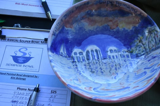 Artist Kim Belange created a couple of Cape Romano-inspired bowls for the silent auction. The Souper Bowl, connecting hundreds of Islanders with soups from nine local eateries, raised funds for Chamber of Commerce scholarships Saturday at Mackle Park.