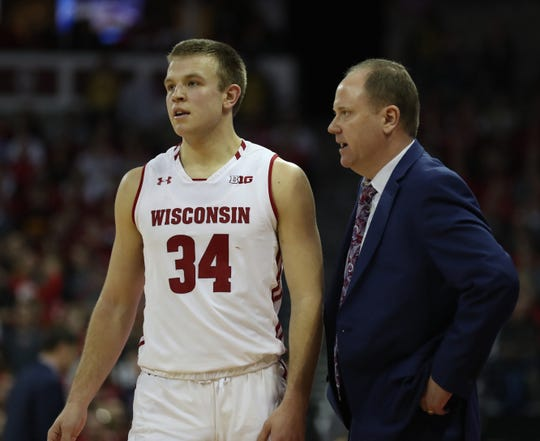 Wisconsin coach Greg Gard talks with guard Brad Davison during the Badgers game against Minnesota on Jan. 3 at the Kohl Center.