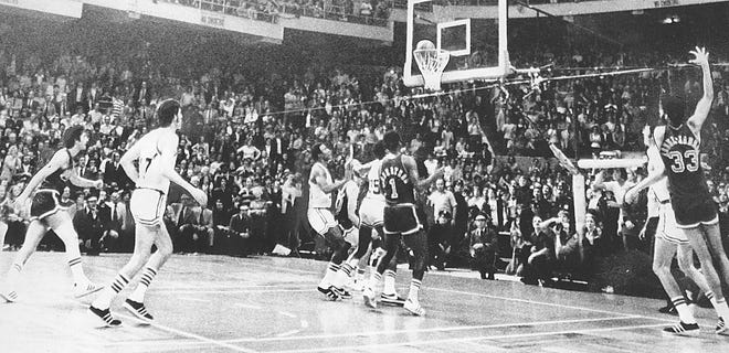 Kareem Abdul-Jabbar, far right, drops the winning basket as the Milwaukee Bucks defeated the Boston Celtics, 102-101, at the Boston Garden to tie the NBA Finals at 3-3 in 1974.