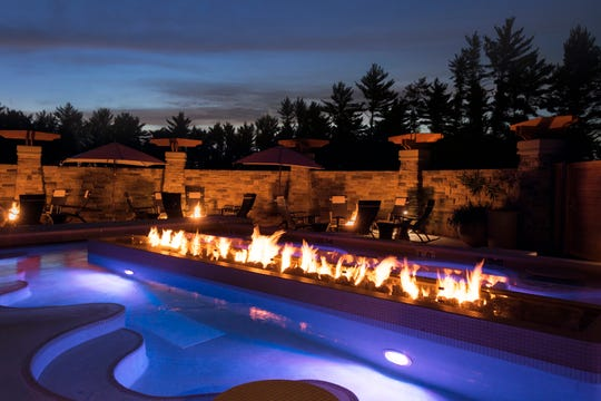 The expansion at Sundara included the addition of a second outdoor pool, this one a saltwater pool, with a dramatic fire feature.