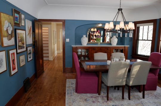 Aileen Smith's dining room is painted a rich blue.