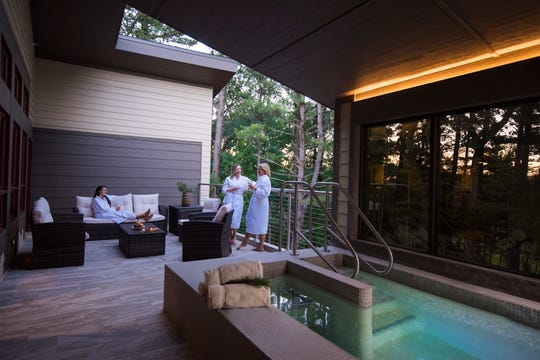 The new Woodland Suites at Sundara feature a private balcony with a heated, over-sized hot soak tub and fireplace.