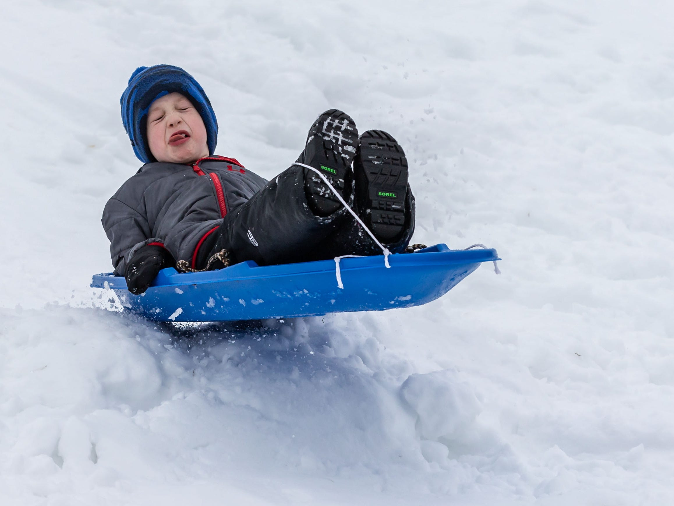 Gibson Herbst, 6, of Mequon holds on tight as he launches off a jump at the Mee-Kwon Park sledding hill in Mequon on Saturday, Feb. 2, 2019. The park is open 7 days a week from 6 a.m. to 9 p.m. but is not lighted.