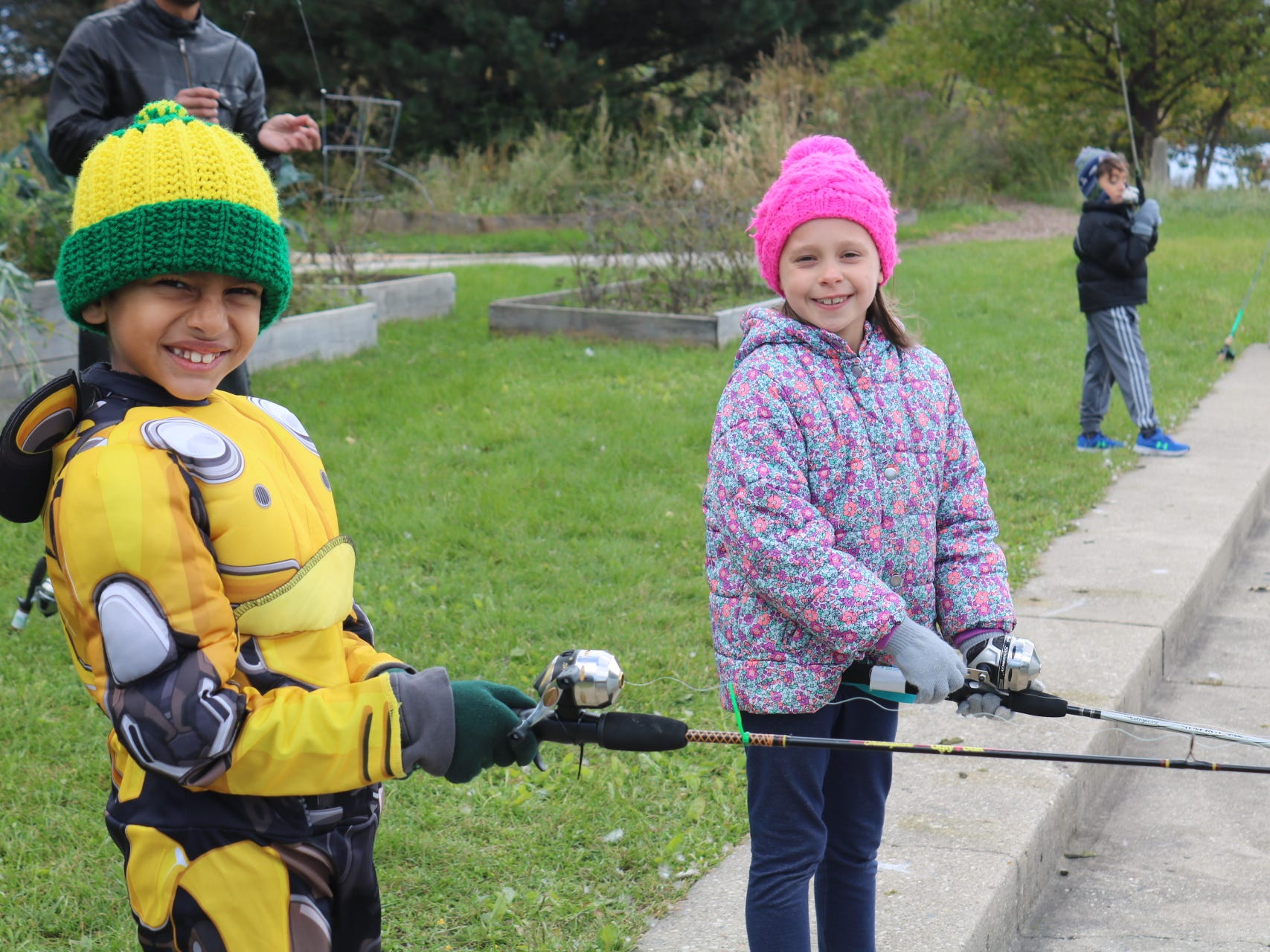 Children at an Urban Ecology Center 'b'earthday' party get some fishing time in.