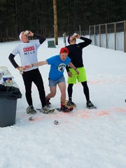 Racers must drink a beer before every lap in the Snowshoe Beer Mile in Eau Claire. Temperatures during the 2018 race were warm enough that some racers wore shorts and T-shirts.
