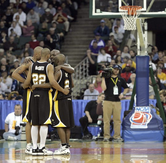 Ed McCants, Joah Tucker (facing camera) and teammates gather during a break in the action in their game against Boston College in Cleveland in the second round of the NCAA Tournament in 2005. UW-Milwaukee won, 83-75.