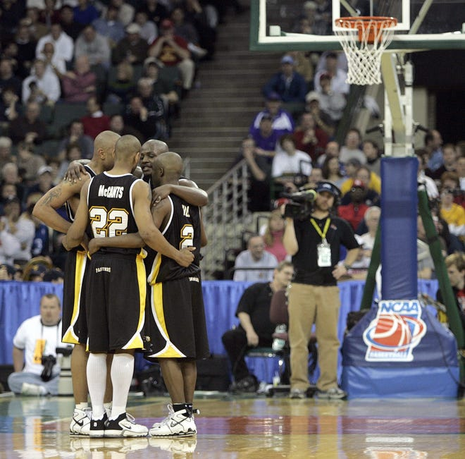 Ed McCants, Joah Tucker (facing camera) and teammates gather during a break in their victory over Boston College in the second round of the NCAA Tournament in 2005. UW-Milwaukee won, 83-75.