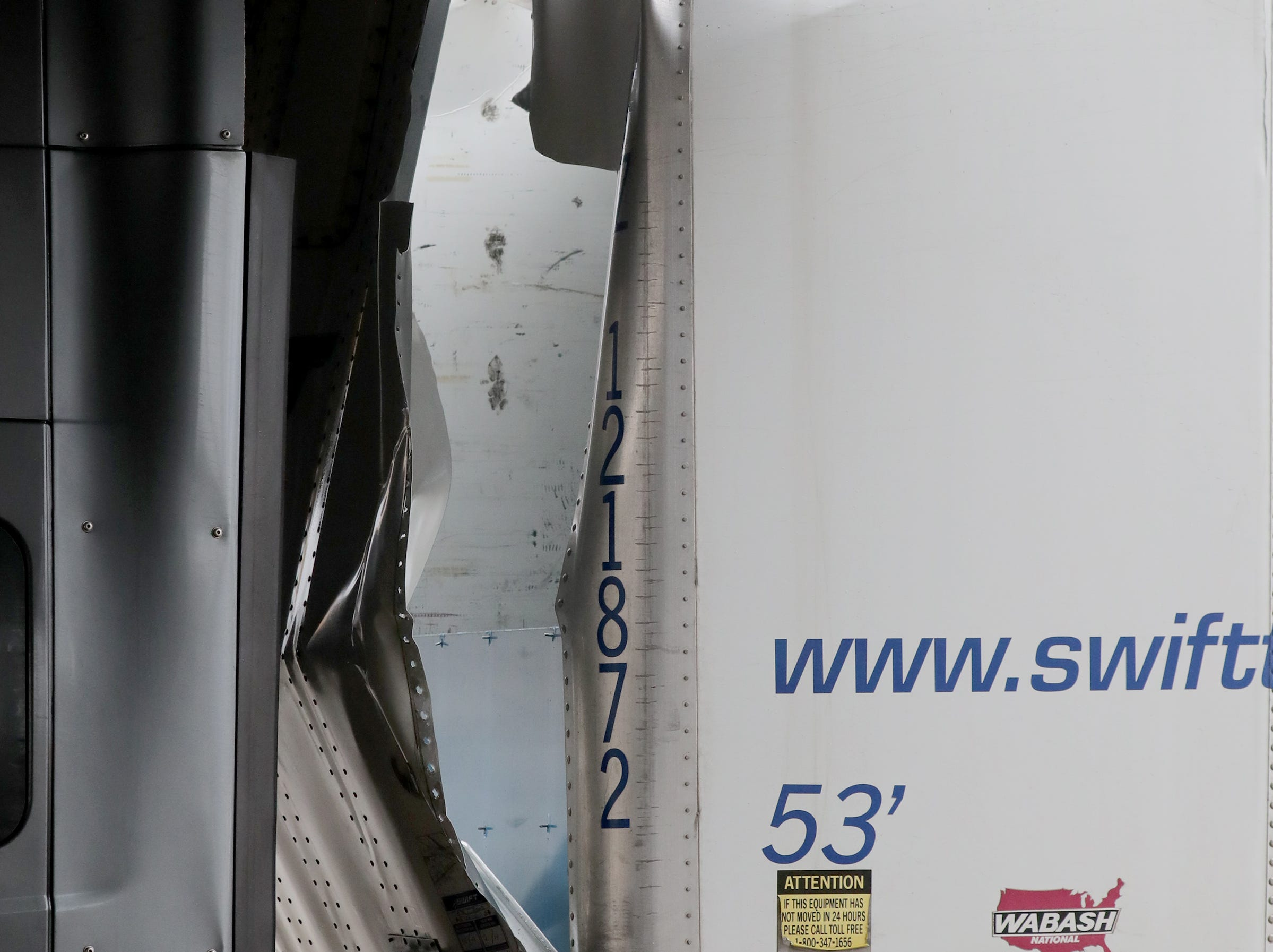 The trailer is damaged of a semi truck is stuck. The trailer was empty.