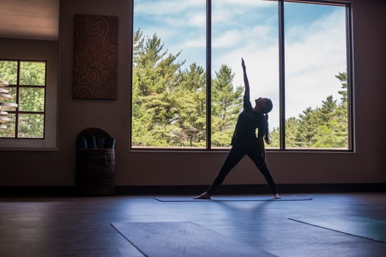 Yoga classes and guided meditation take place in spaces with inspiring views of pine forest at Sundara.
