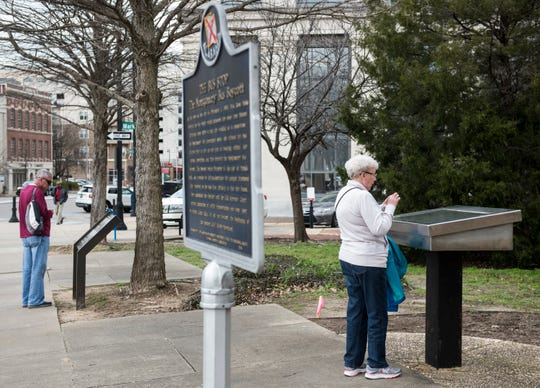 Dave and Jane Stickel of Dayton, Ohio checkout the markers of the Rosa Parks bus stop on Parks' birthday in Montgomery, Ala., on Monday, Feb. 4, 2019.