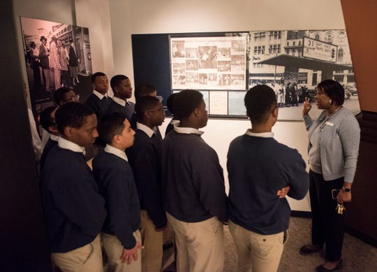 Dr. Felicia Bell, director of the Rosa Parks Museum, leads a tour during Rosa Parks birthday in Montgomery, Ala., on Monday, Feb. 4, 2019.