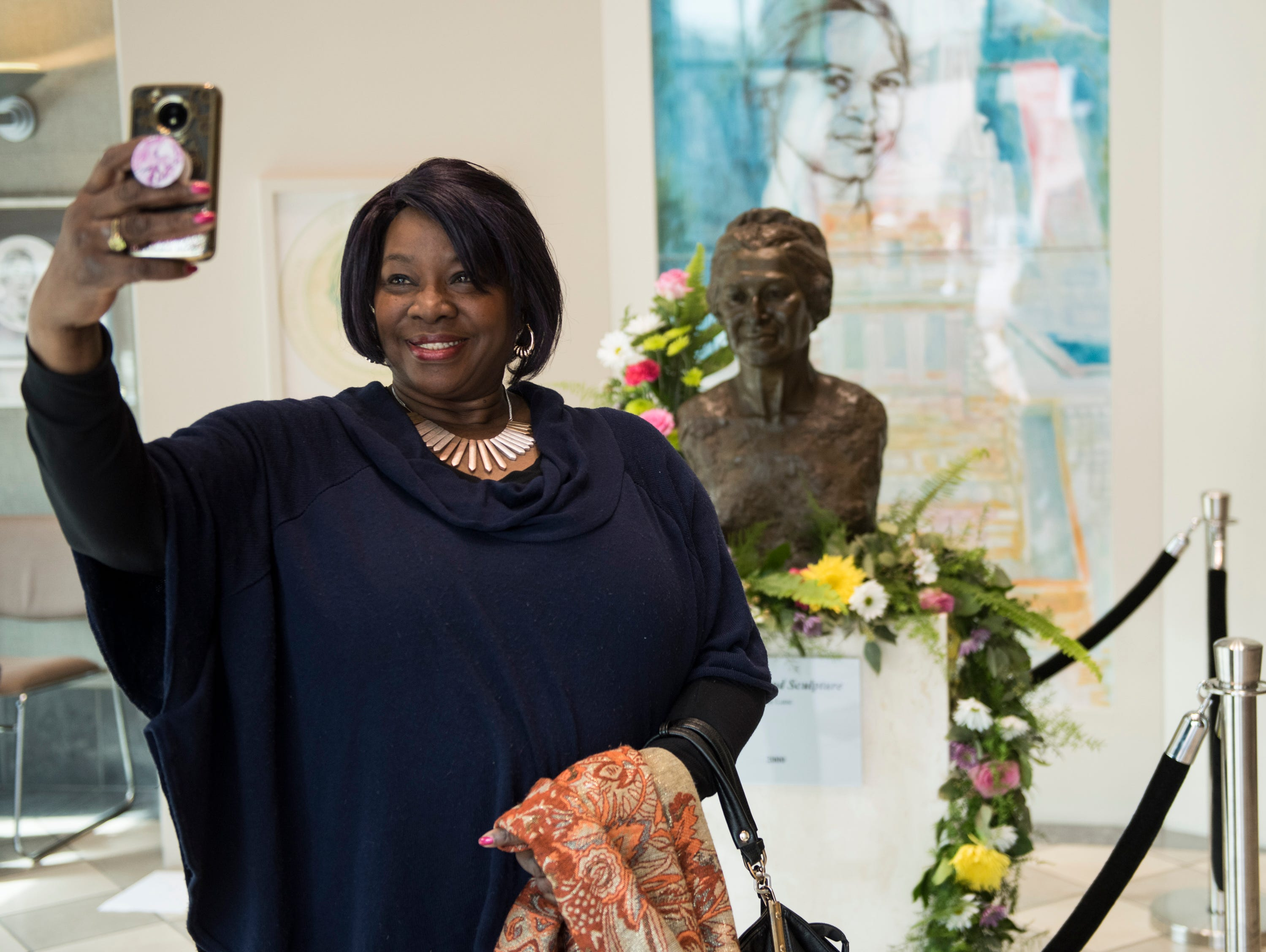 Silvia Norman, takes a selfie with a Rosa Parks statue during Parks' birthday celebration at the Rosa Parks Museum in Montgomery, Ala., on Monday, Feb. 4, 2019.