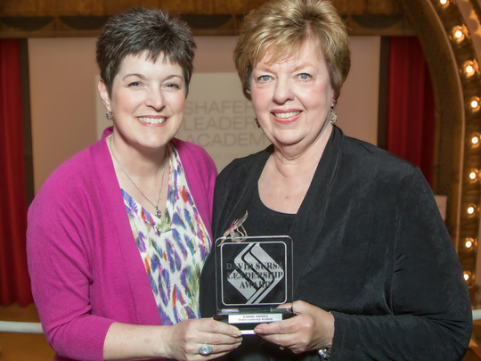 Kelly K. Shrock (at left, president of the Community Foundation of Muncie and Delaware County, poses with Jeannine Harrold, the 2018 recipient of the David Sursa Leadership Award.