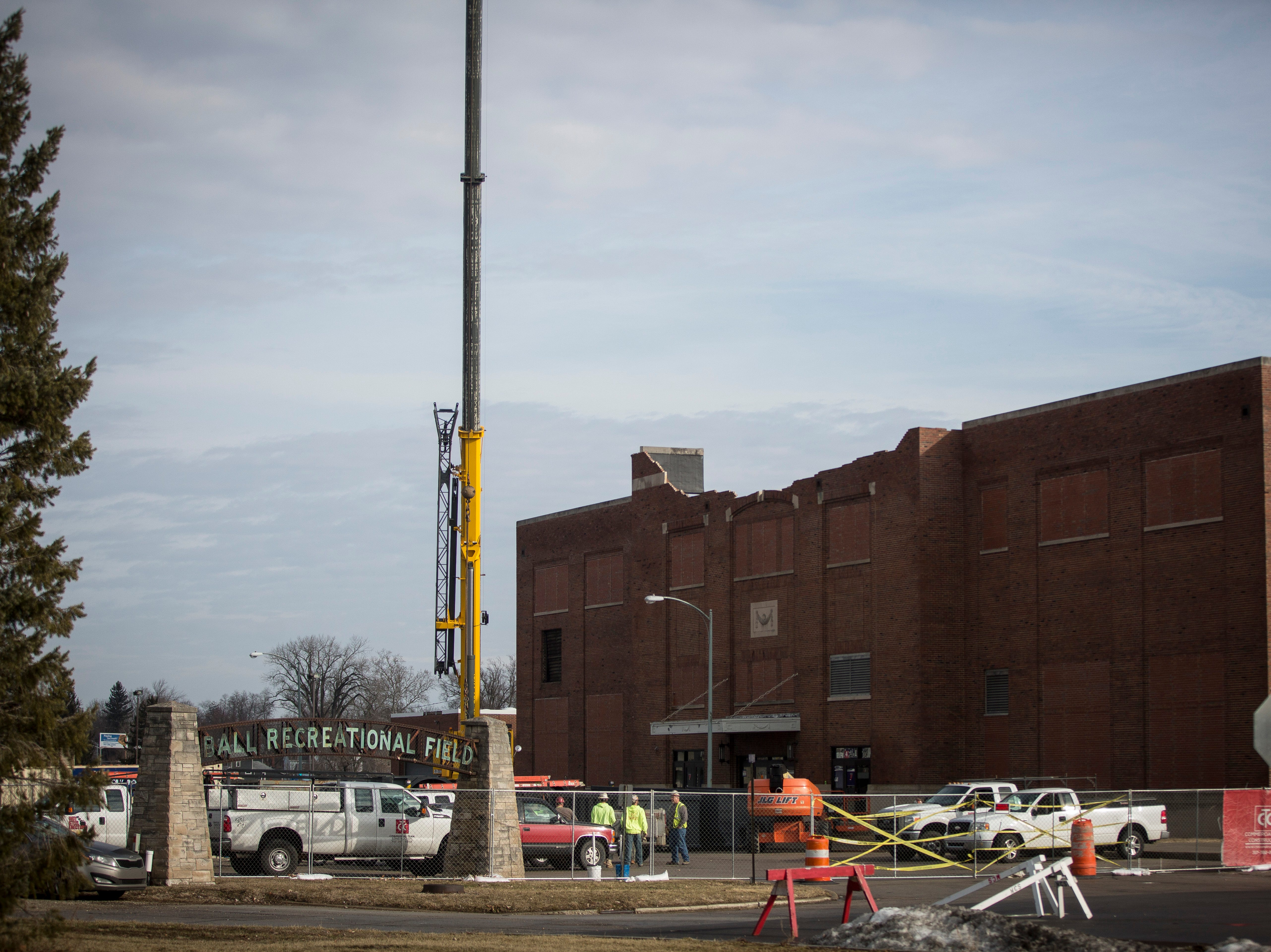 Construction crews and a crane begin work on the Muncie Central Fieldhouse Monday morning before rain swept through the area. Workers removed the roof of the historic building Monday, with officials saying that the new roof would be completed by the first week of March.
