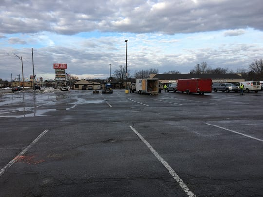 On Monday, Feb. 4, crews were beginning to fence off the portion of Muncie Pay Less's McGalliard Road parking lot that will be the location of a new Pay Less Fuel Center.
