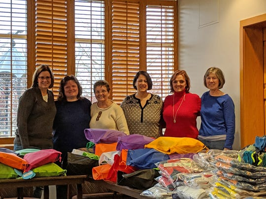 Altrusa International of Muncie members pose with care bag items purchased for the Delaware County Foster Closet with grant funding from Altrusa International.