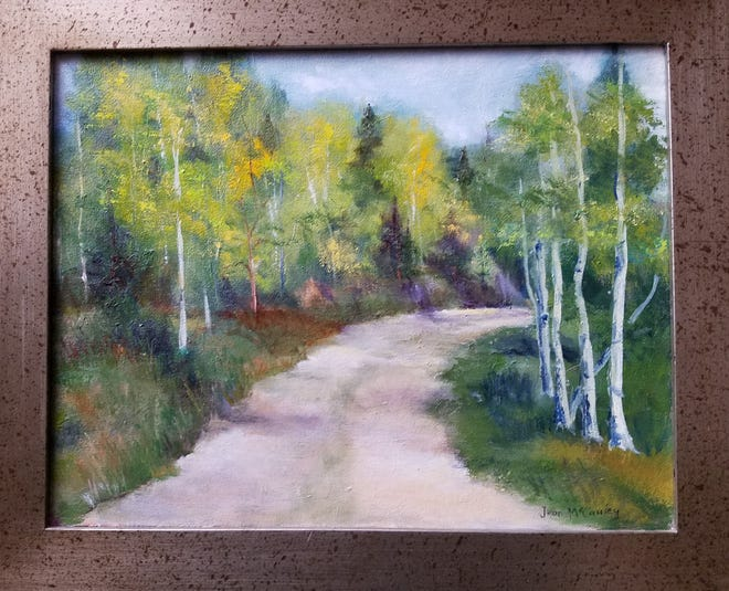 """Local artist Jean McCauley's oil painting """"Mountain Road, Santa Fe"""" will be on display for February 2019 at Old National Bank in downtown Muncie."""
