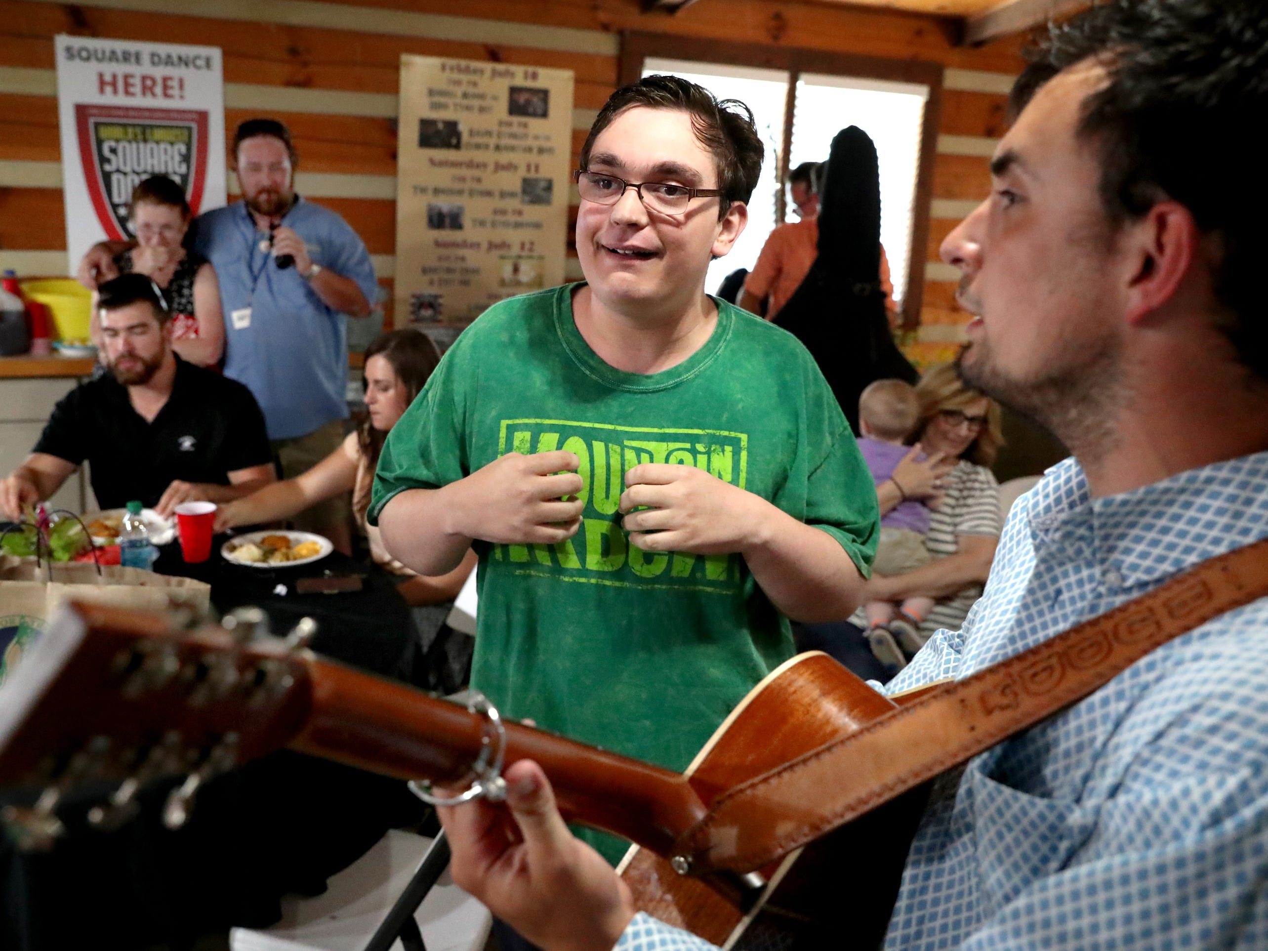 Kyle Nelson, who traveled from northern Minnesota, to see his favorite band Flatt Lonesome, sings with the band as he meets them before they perform at the 41st annual Uncle Dave Macon Days Festival on Friday, July 13, 2018.