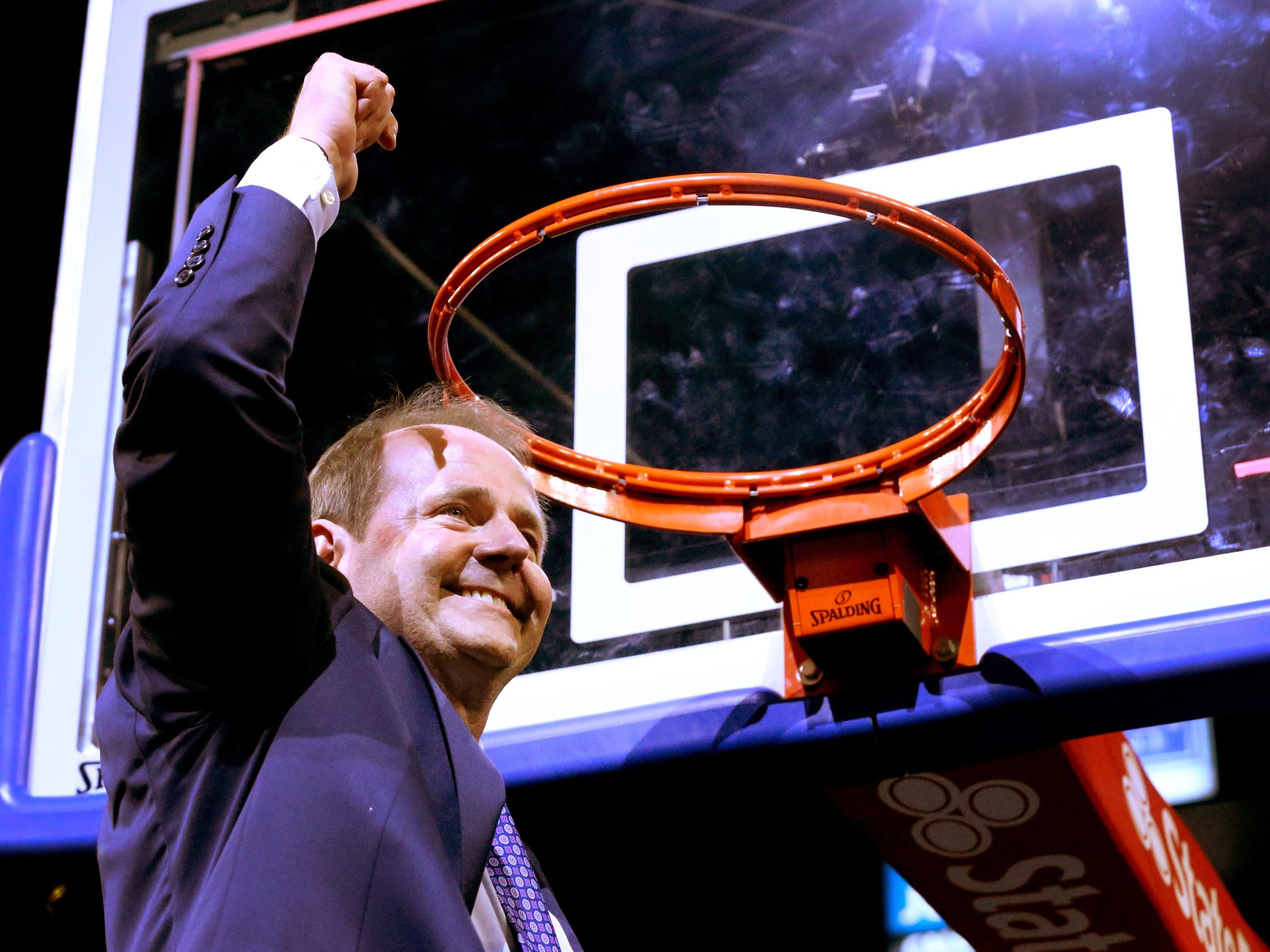 MTSU's head coach Kermit Davis celebrates winning the conference title 2 years in a row after cutting down the net and beating Western Kentucky 82-64 on Thursday, March. 1, 2018, at MTSU.
