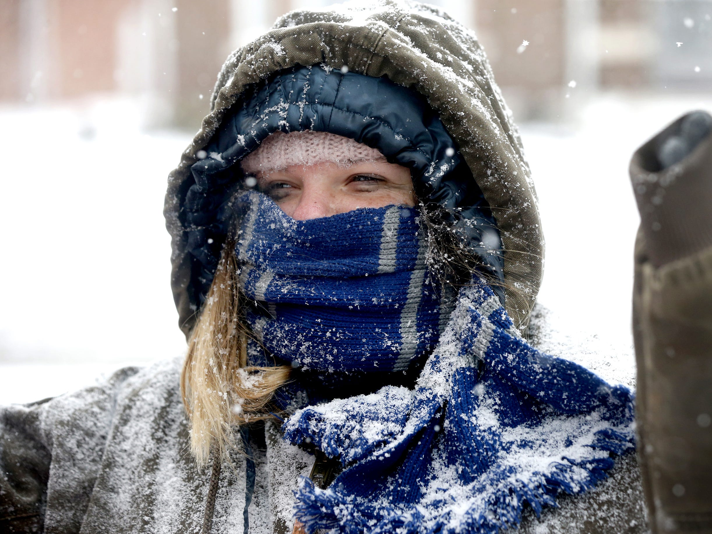 Amanda Eckardt, is covered in snow in downtown Murfreesboro as she walks to breakfast on Tuesday, Jan. 16, 2018.